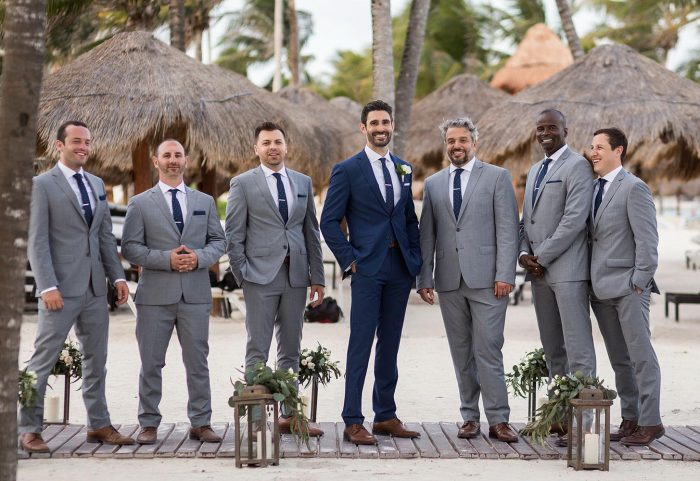Groomsmen on beach in Cancun