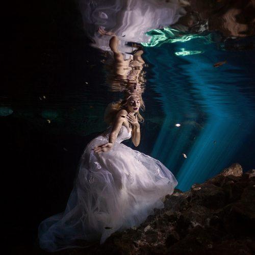 Bride underwater in Cenote Trash the Dress, Mexico