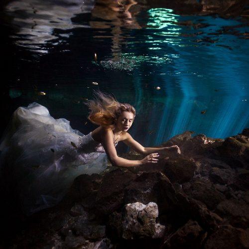 Bride in wedding dress underwater in Mayan Cenote Trash the Dress