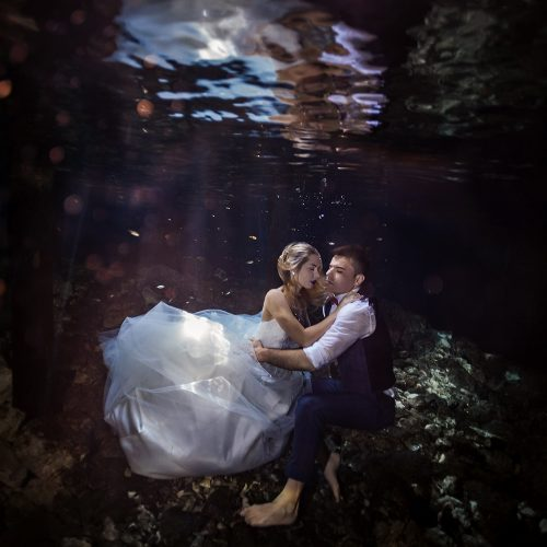 Bride and groom underwater in cenote TTD