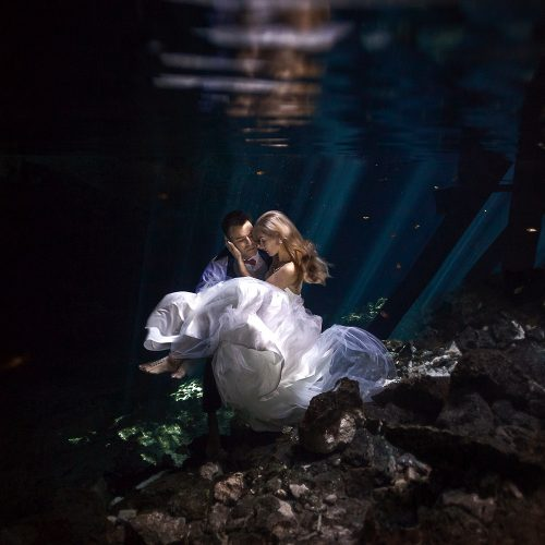 Bride and groom underwater in Mayan Cenote Trash the Dress
