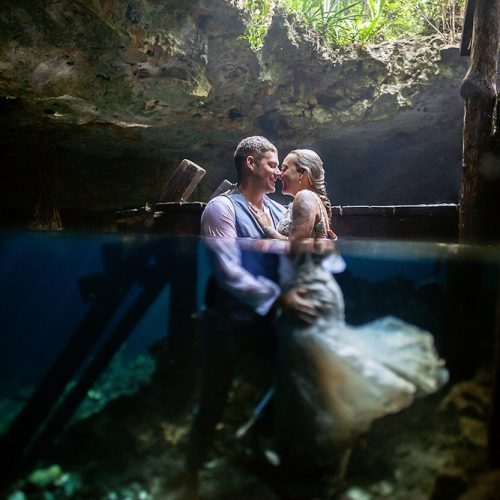 Bride and groom half underwater in Mayan Cenote Trash the Dress