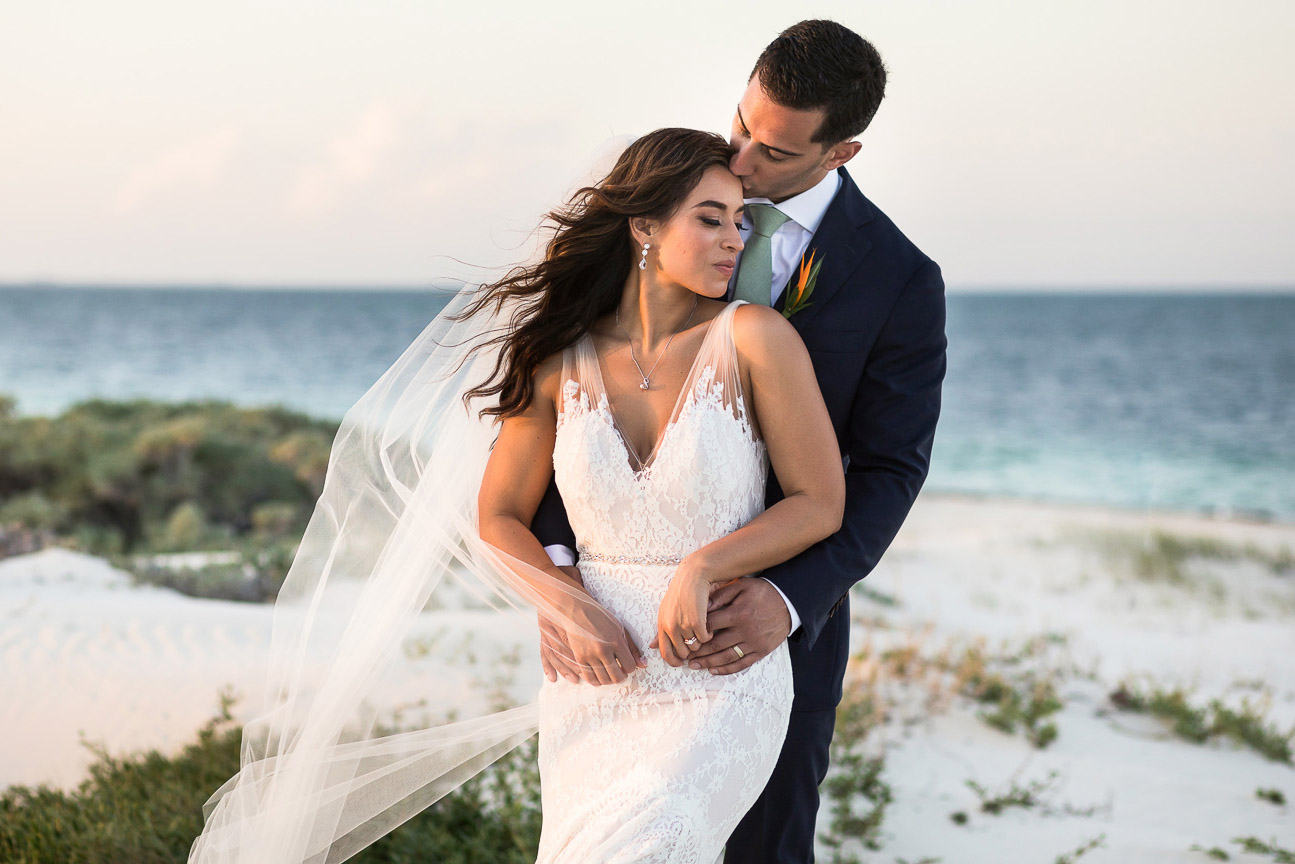 Bride and Groom on beach at their wedding in Cancun